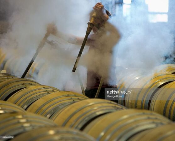 cellar-worker-at-kosta-browne-winery-uses-high-heat-steam-to-wooden